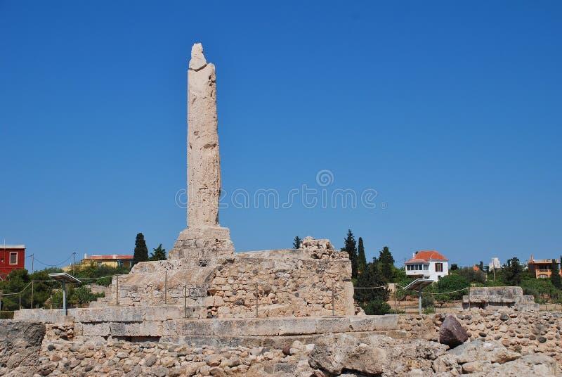 Temple of Apollo, Aegina. The remaining column of the Temple of Apollo at Aegina Town on the Greek island of Aegina. The ancient acropolis dates from circa 6th royalty free stock photos