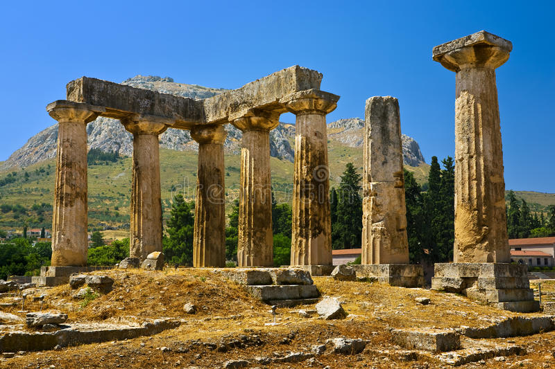 Temple of Apollo. Greece. Ancient Corinth. The Doric temple of Apollo (6th century BC); in the background - Acrocorinth with fortified citadel formed on the top stock images