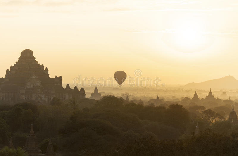 Temple in Bagan (Myanmar) with hot air balloon stock image
