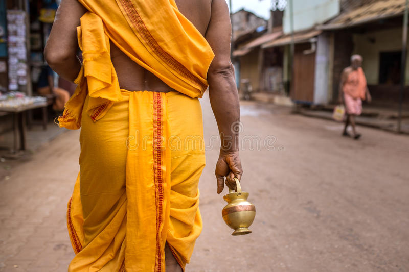 Temple brahmin walk on the streets of Gokarna. Unidentified temple brahmin walk on the streets of Gokarna. The city is a holy pilgrimage site for Hinduists stock images