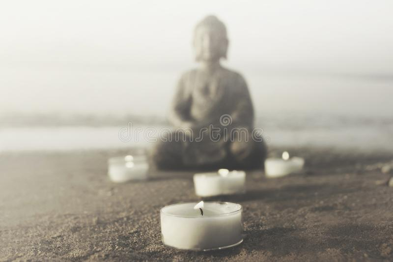 Temple with buddha statue and lit candles that illuminate the spirit. In the middle of nature stock photos