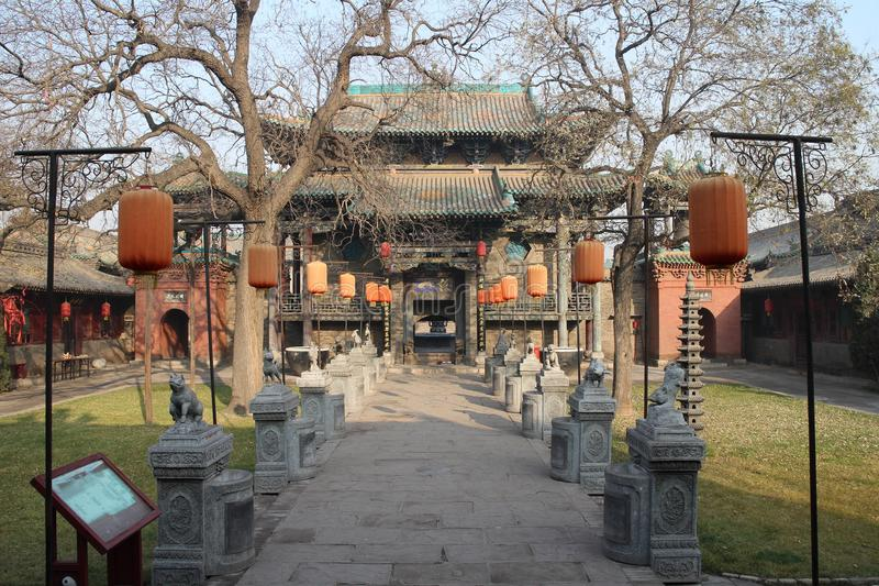 A temple and stone carvings. A temple and Chinese Zodiac stone carvings royalty free stock photos