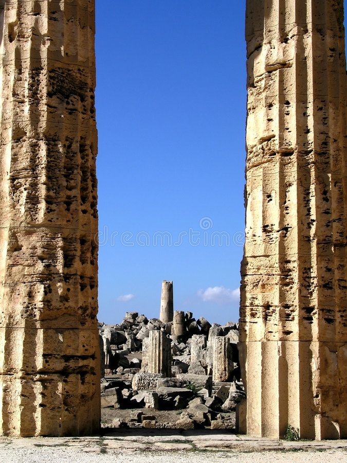 Temple columns and ruins. Temple columns with ruins in the background stock image