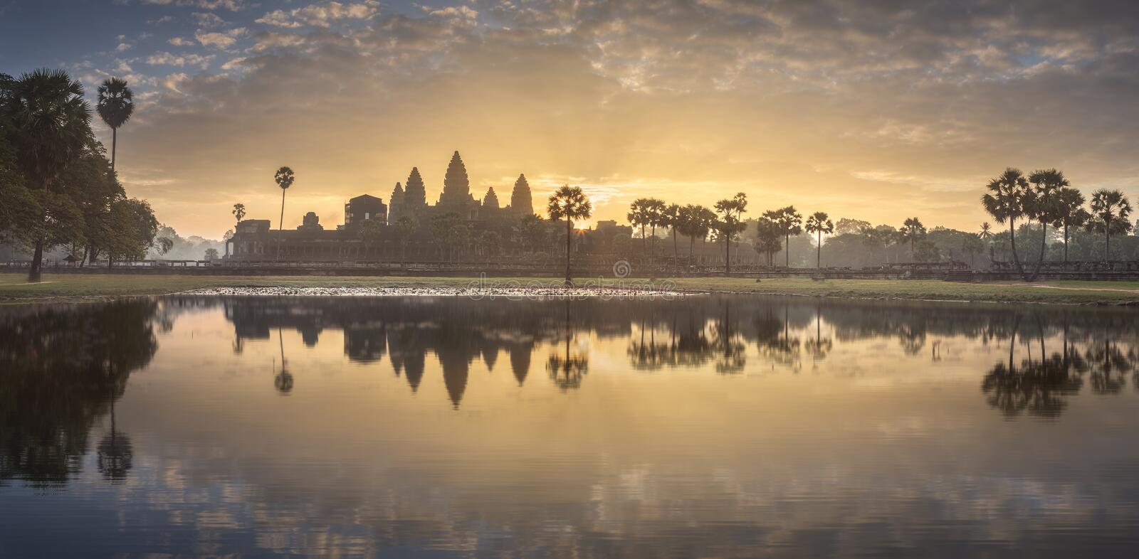 Temple complex Angkor Wat Siem Reap, Cambodia. Sunrise view of popular tourist attraction ancient temple complex Angkor Wat with reflected in lake Siem Reap royalty free stock images