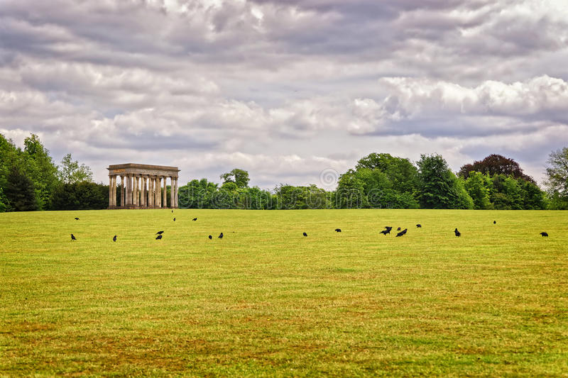 Temple of Concord and rooks in Park of Audley End royalty free stock photos