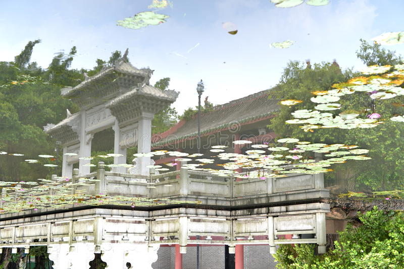 A temple covered by a lake. At first glance, it looks like an unclear picture. Actually, it's the reflection in water. I just put it upside down stock image