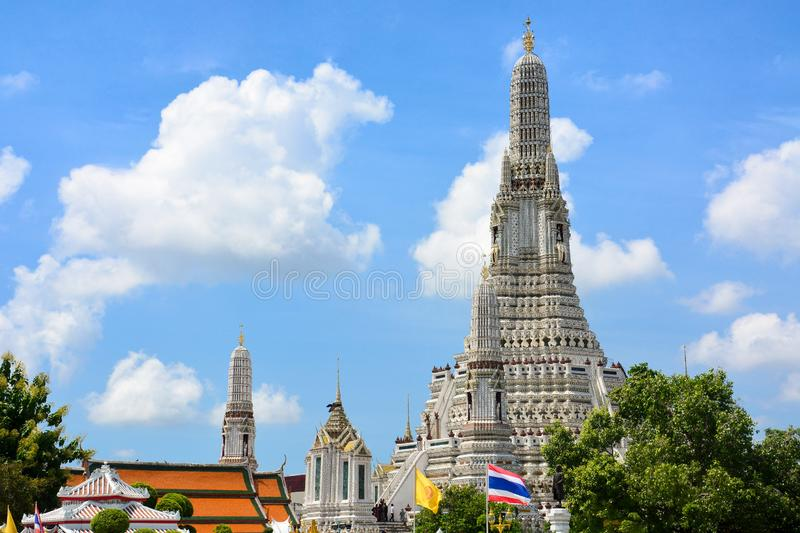 The Temple of Dawn or Wat Arun Buddhist temple with a beautiful blue sky and clouds background. Copy space, This place is a popular travel destination among stock image