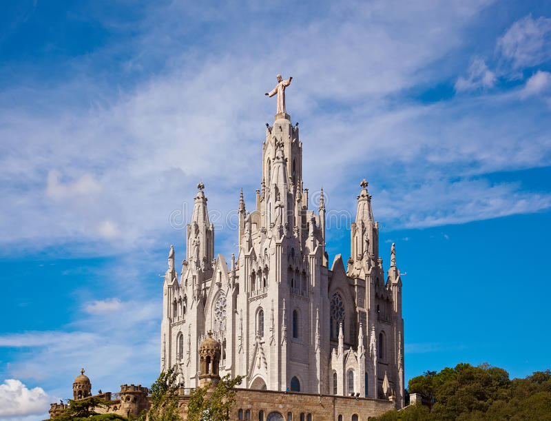 The Temple del Sagrat Cor (Church of the Sacred Heart). Barcelona. Spain. Jesus Christus Statue (by Josep Miret) at Expiatory Church of the Sacred Heart of stock photography