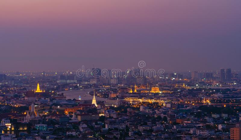Temple of the Emerald Buddha, Grand palace, Wat Pho, Wat Phra Kaew, and skyscraper buildings with Chao Phraya River. Bangkok City. In downtown area at night stock photo
