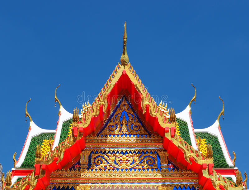 Temple gable soaring in blue sky. Colorful temple gable soaring in blue sky at Wat Lahan in Nonthaburi province of Thailand stock photography