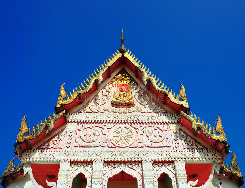 Temple gable soaring in blue sky. At Wat Khuan Suban in Surat Thani province of Thailand stock photos