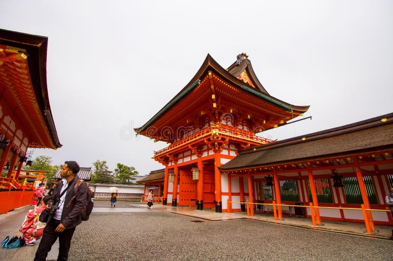 Tourists inside the temple grounds taking photos royalty free stock image