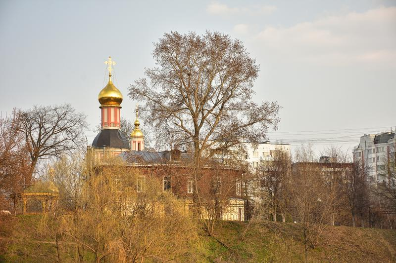 Temple with golden dome on hill in spring royalty free stock photos