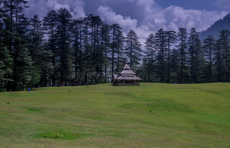 A Temple in Green meadows in himalayas, Great Himalayan National Park, Sainj Valley, Himachal Pradesh, India. Photo of Temple in Green meadows in himalayas stock photography