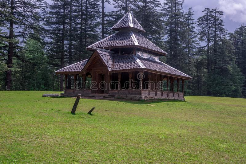 A Temple in Green meadows in himalayas, Great Himalayan National Park, Sainj Valley, Himachal Pradesh, India. Photo of Temple in Green meadows in himalayas royalty free stock photography