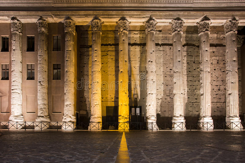 Temple of Hadrian, night illuminated columns stock photo