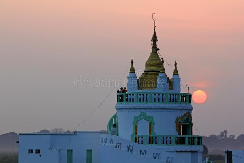 The temple has white and sunset in Myanmar. royalty free stock photo