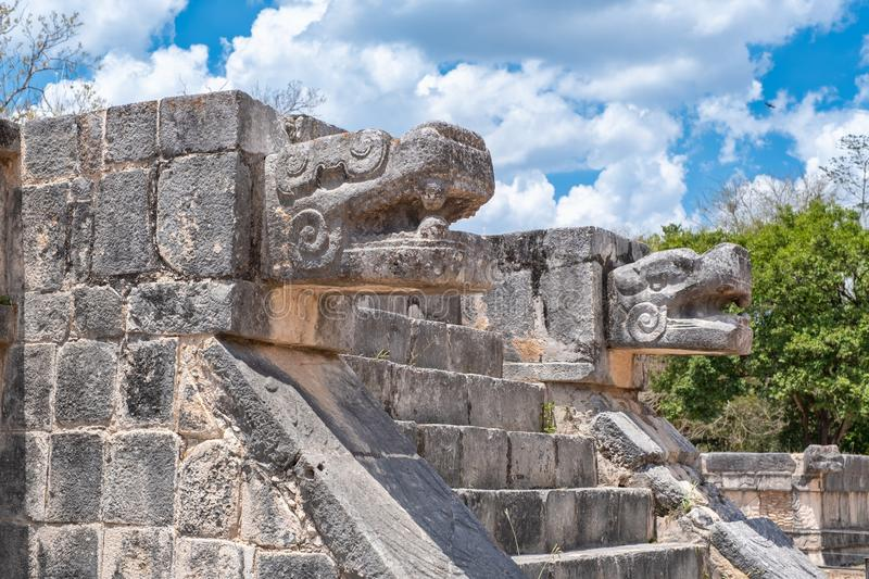 Temple with the head of the snake god Kukulkan at Chichen Itza in Mexico. Temple with the head of the snake god Kukulkan at the ancient mayan city of Chichen royalty free stock image