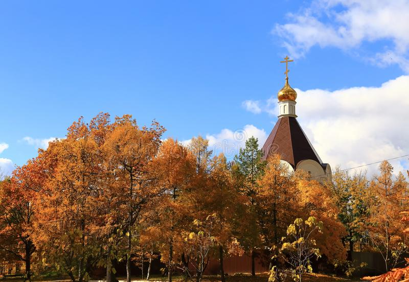 A temple in honor of the Holy Prince Alexander Nevsky in the autumn park. Victory Park, Saratov, Russia stock photos