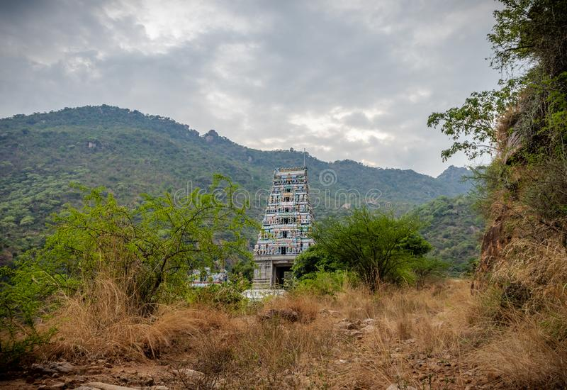 Temple India marudhamalai coimbatore view. This is the image of marudhamalai Temple coimbatore tamilnadu india. Image is taken with hill in background and bush royalty free stock image
