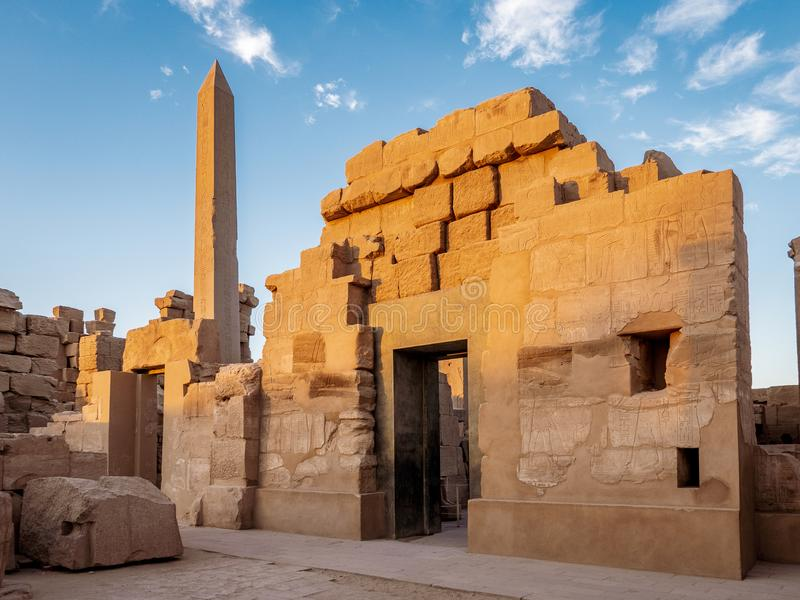 Temple of Karnak known as Karnak in Luxor with the Great Obelisk and ancient hieroglyphics on the stone walls royalty free stock photography