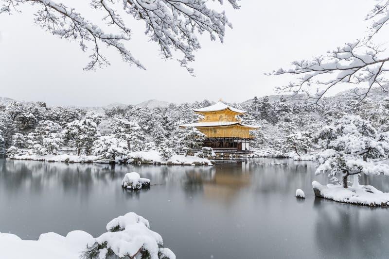 Temple Kinkakuji Golden Pavilion with snow fall stock photos