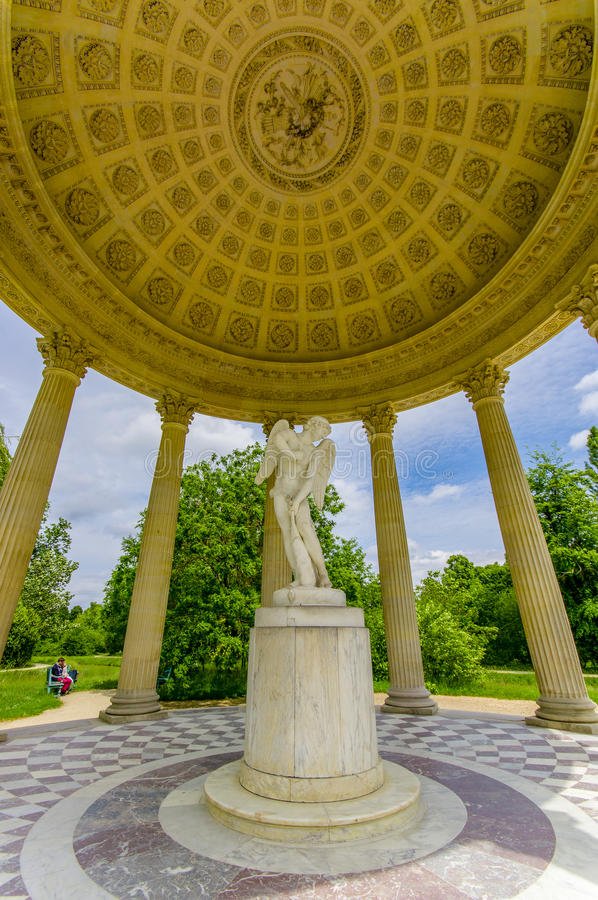 The Temple of Love, located behind Petit Trianon. PARIS, FRANCE - JUNE 1, 2015: The Temple of Love, located in the gardens behind Le Petit Trianon in Versailles stock photos