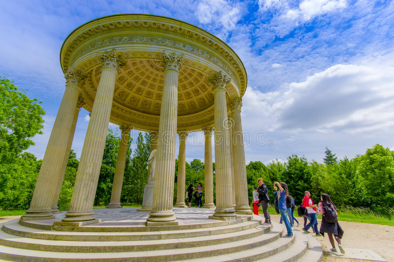 The Temple of Love, located behind Petit Trianon. PARIS, FRANCE - JUNE 1, 2015: The Temple of Love, located in the gardens behind Le Petit Trianon in Versailles royalty free stock images