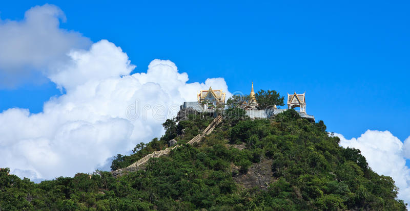 Temple on mountain and blue sky, Thailand stock photos