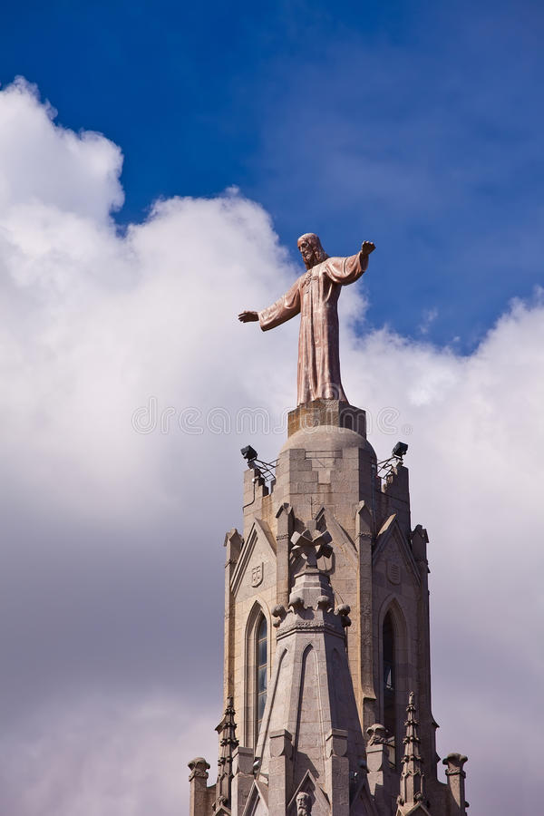Temple on mountain top - Tibidabo in Barcelona city. Spain. Jesus Christus Statue (by Josep Miret) at Expiatory Church of the Sacred Heart of Jesus (Temple stock photography