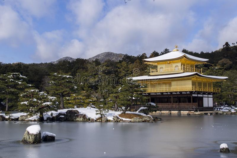 Temple Near Body Of Water Surrounded By Trees With Mountain Background royalty free stock photography