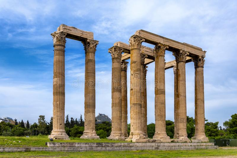The Temple of Olympian Zeus, also known as the Olympieion or Columns of the Olympian Zeus, is a former colossal temple at the cent. Athens, Attica / Greece. The royalty free stock photo