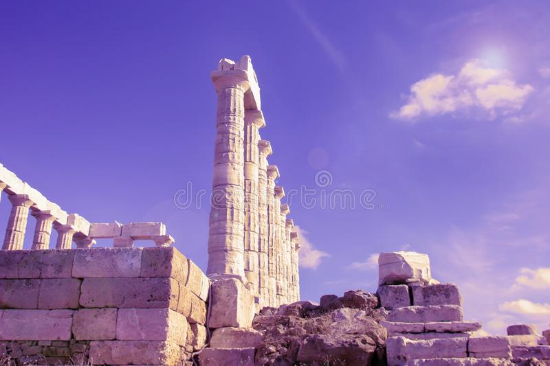 The Temple of Poseidon and blue purple sky. Cape Sounion, Greece royalty free stock photo
