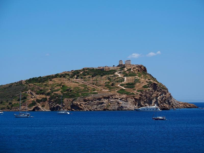 Temple of Poseidon at Cape Sounion. Ancient ruins of The Temple of Poseidon on top of the promontory at the southernmost point of Attica in Greece royalty free stock image