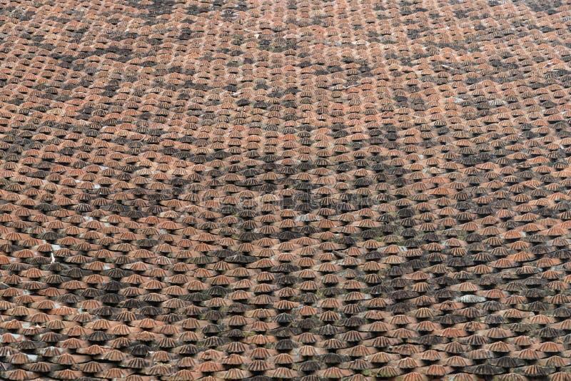 Temple roof tiles in Vietnam Some orange, some black, stock image