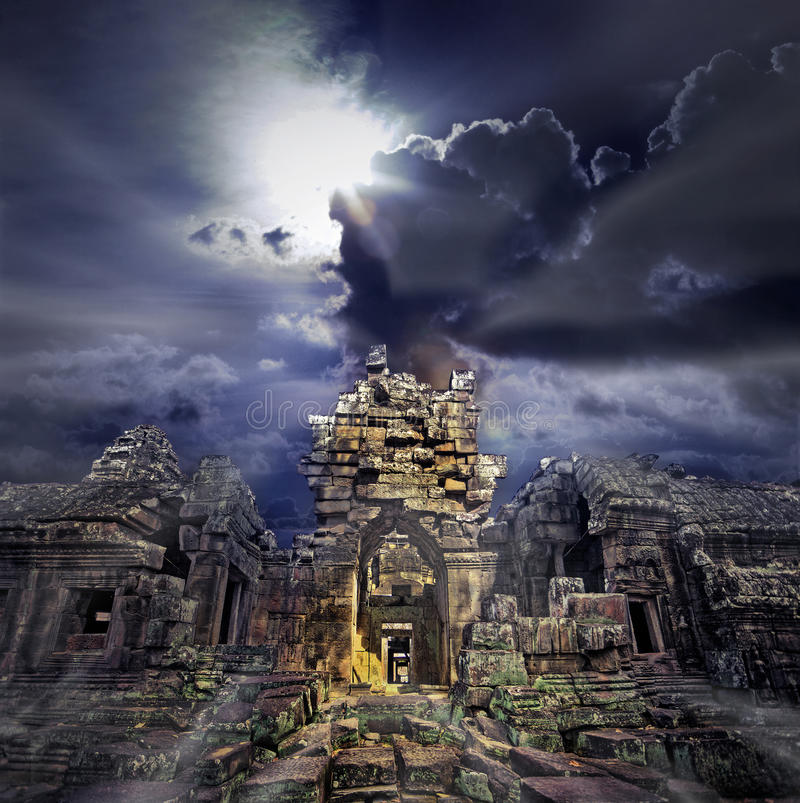 Temple ruins. Cambodian temple ruins turning to rubble, blue sky background royalty free stock photography