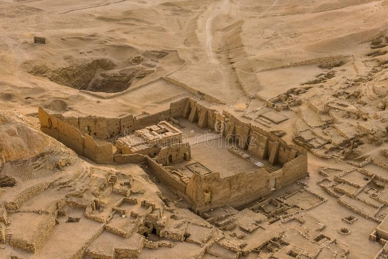 A temple among the ruins at the village of the Workers at Deir El-Medina. Temple-ruins at the village of The Workers at Deir El-Medina, a view from a hot air stock image