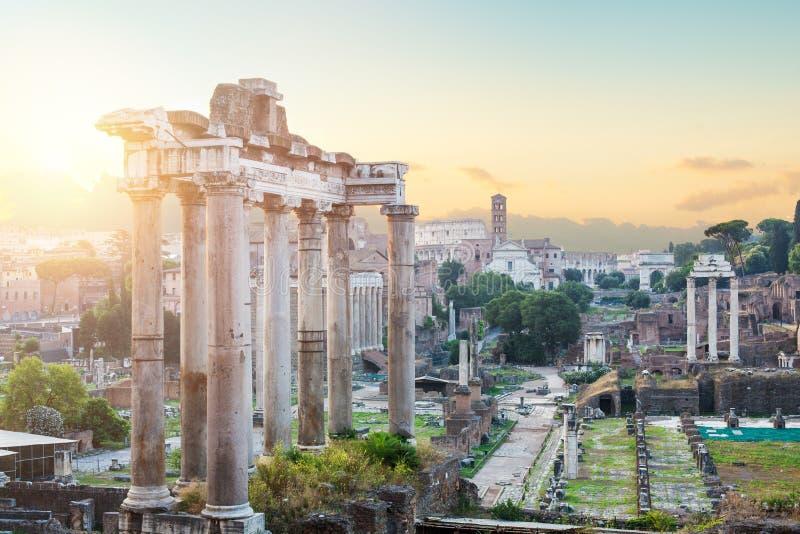 Temple of Saturn, Roman forum ethernal city architectural ruin. City center Rome, Italy.  stock photos