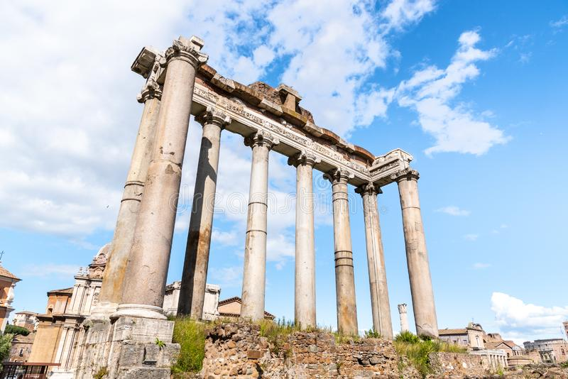 Temple of Saturn - ruins with old historical columns. Roman Forum archeological site, Rome, Italy.  stock photography