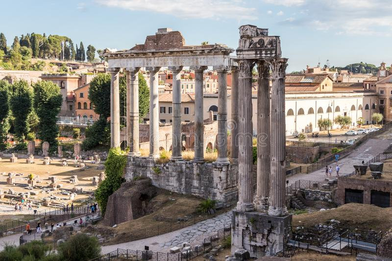 The Temple of Saturn and the Temple of Vespasian. The Temple of Saturn was used always as the public treasury, sacred treasures were held in underground chambers stock photos