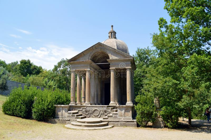 Temple. A shot of the Parco dei Mostri (Park of the Monsters), in Bomarzo (Viterbo, Italy) that shows the Temple in the upper part of the park. The gardens are a stock photography