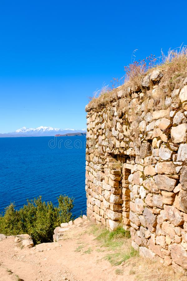 Temple of the Sun in Bolivia. Stone wall at the Templo del Sol, or the Temple of the Sun, at the Isla del Sol, or the Island of the Sun with the Lake Titicaca in royalty free stock photo