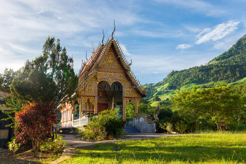 Temple in thailand near mountain valley during sunrise Natural s stock photo