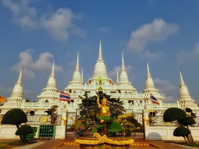 Temple in Thailand. At Wat Asoka-ram temple in Thailand.A larger white pagoda with multiple spires royalty free stock image