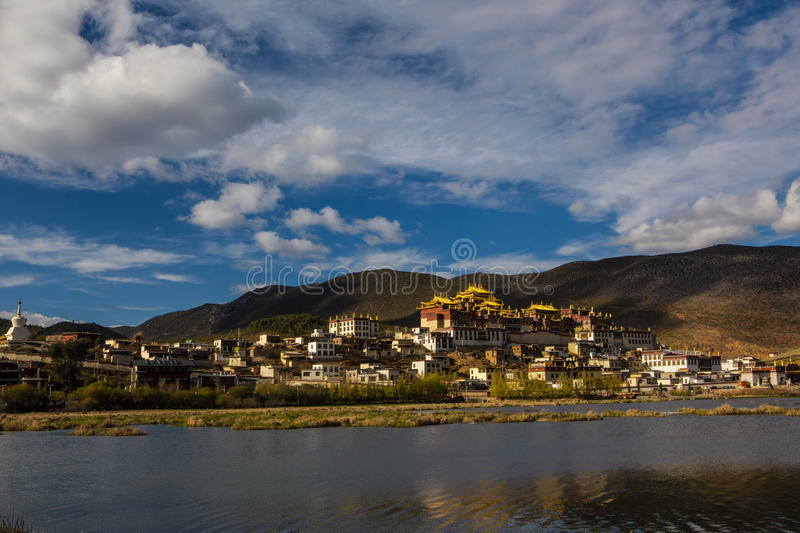 Temple in tibet. At blue sky at noon, Songzanlin temple, panorama view with Lama royalty free stock photos