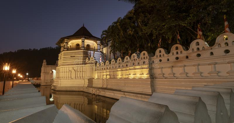 Temple of the Tooth Relic and Reflections Before Dawn in Kandy Sri Lanka.  stock photography