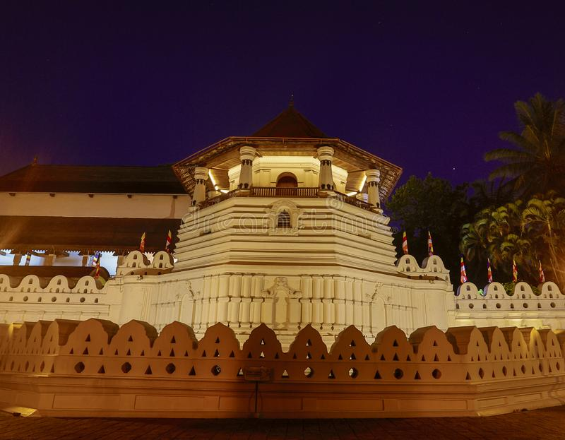 Temple of the Tooth Relic and Reflections Before Dawn in Kandy Sri Lanka.  royalty free stock image