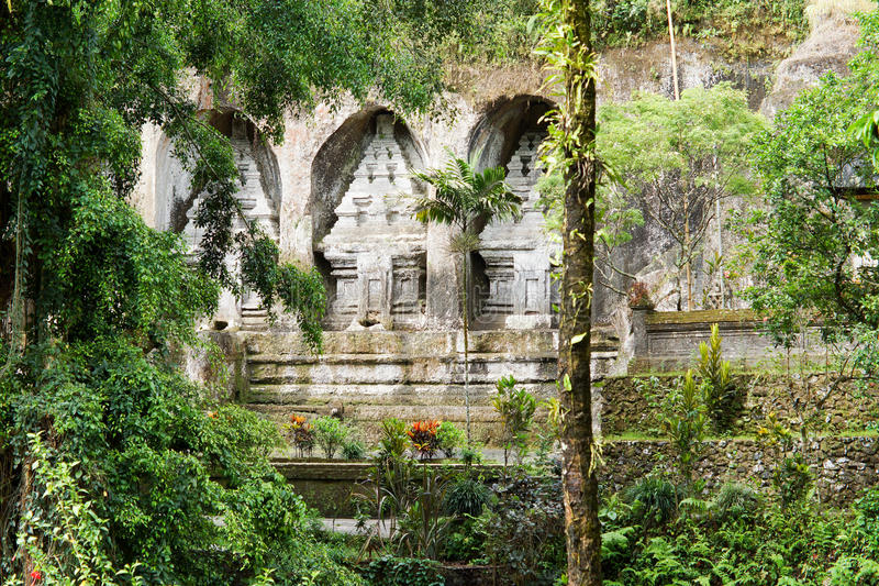 Temple wall amongst tropical vegetation royalty free stock images