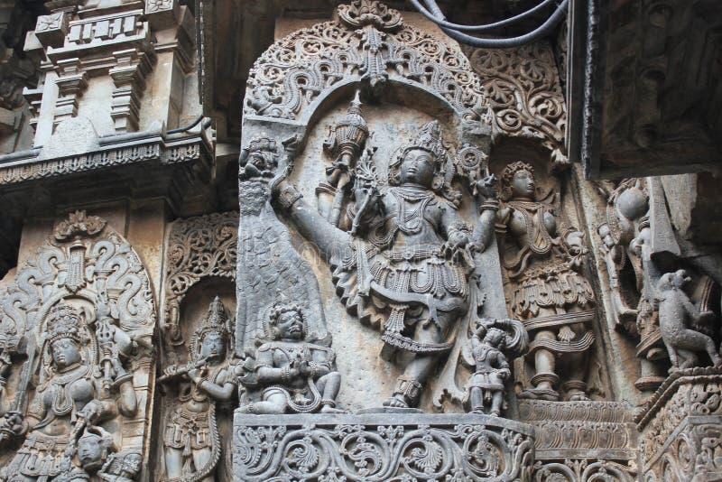 Hoysaleswara Temple Wall carved with sculpture of ulagatha perumal incarnation of lord vishnu royalty free stock photos