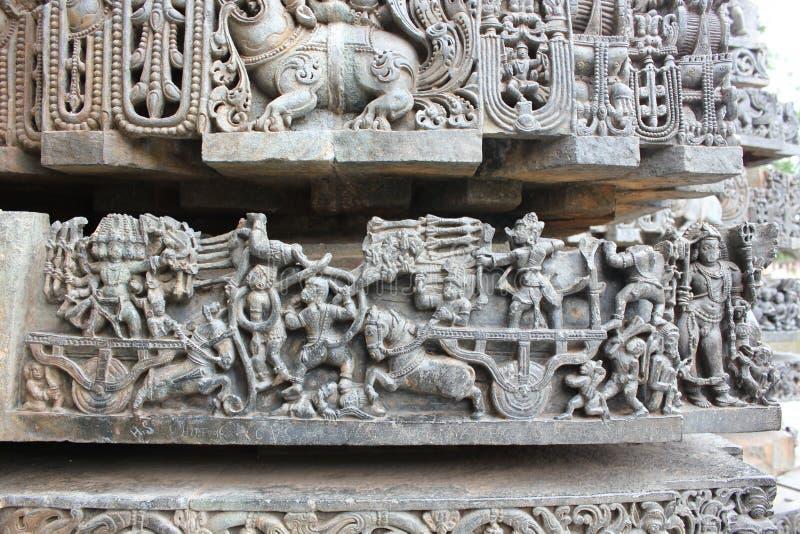 Hoysaleswara Temple Wall carving of war scene of Ramayana - Rama fighting with Ravana demon king stock photos